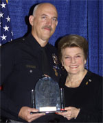 George L. Shake (left) from the Los Angeles Police Department accepts his award from POST Commission Chair Collene Campbell