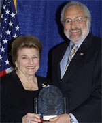 Attorney at Law Martin (Marty) J. Mayer (right) accepts his award from POST Commission Chair Collene Campbell