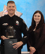 Sergeant Raymond Backman (left) from the Oakland Police Department accepts his award from Deputy Director Lindsay E. Barsamian-Kelsch, Office of Governor Arnold Schwarzenegger, Fresno Field Office