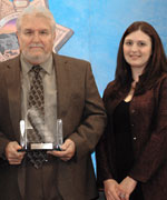 Retired Sergeant Kenneth Whitley (left) of the Garden Grove Police Department accepts his award from Deputy Director Lindsay E. Barsamian-Kelsch, Office of Governor Arnold Schwarzenegger, Fresno Field Office