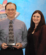 Nick Flint, Director of the Behavior Analysis Training Institute (BATI), (left), accepts the award on behalf of the BATI from Deputy Director Lindsay E. Barsamian-Kelsch, Office of Governor Arnold Schwarzenegger, Fresno Field Office.